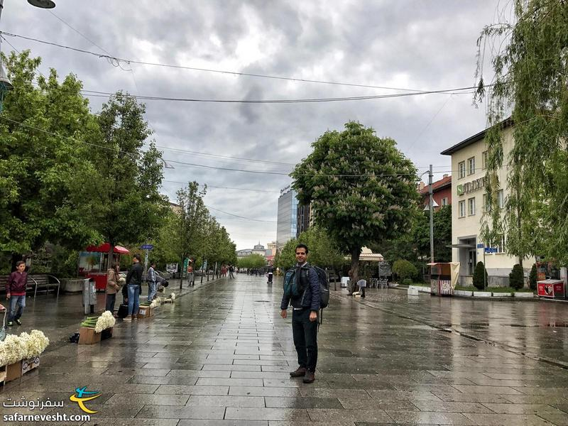 Walking to Pristina bus terminal on a rainy Sunday